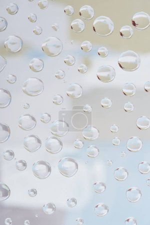 beautiful transparent rain drops on blurred abstract background