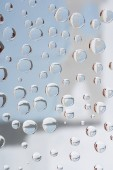 close-up view of beautiful transparent droplets on blurred abstract background