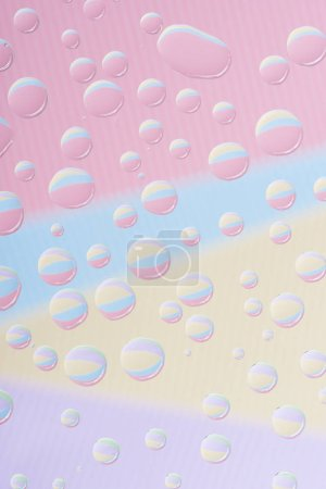 close-up view of transparent water drops on abstract background