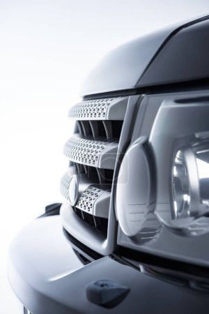 Close up view luxury cars headlight on grey background