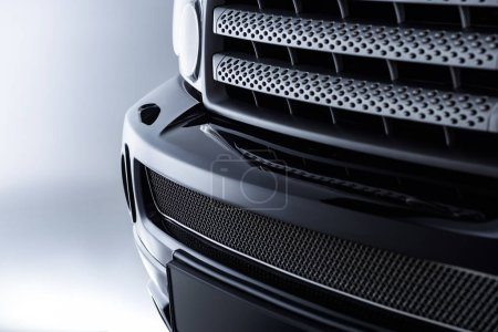 close up view of black automobile as background