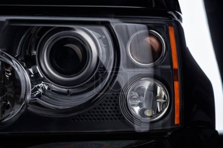 Close up view of automobiles headlight as background