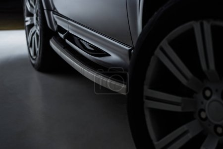 Photo for Close up view of black automobile as background - Royalty Free Image