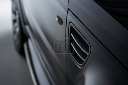 close up view luxury shining black automobile