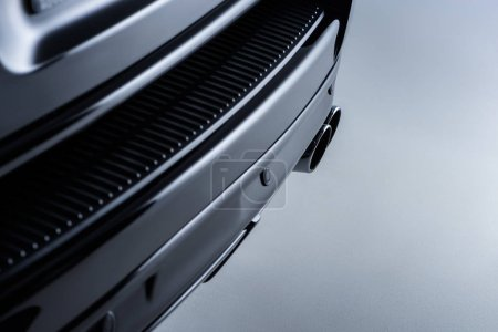 close up view of black luxury car on grey backdrop