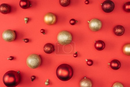top view of red and golden decorative christmas balls isolated on red