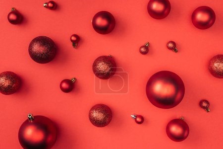 top view of red decorative christmas balls isolated on red