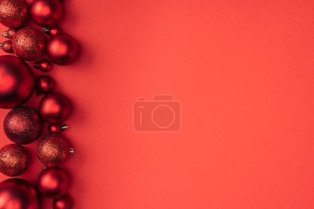 top view of decorative red christmas balls isolated on red