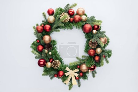 Photo for Top view of decorative festive wreath with red and golden christmas toys isolated on white - Royalty Free Image