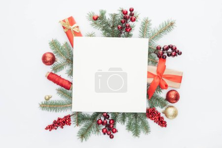 Photo for Top view of pine tree branches, christmas decorations and gifts with square blank space in middle isolated on white - Royalty Free Image