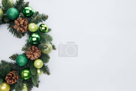 Photo for Top view of decorative festive wreath with green christmas toys isolated on white - Royalty Free Image