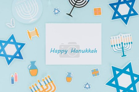 Photo for Flat lay with hannukah holiday paper signs and happy hannukah card isolated on blue, hannukah concept - Royalty Free Image
