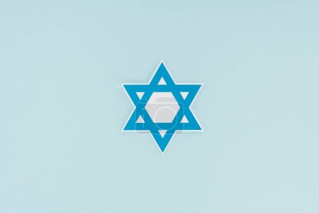 top view of traditional jewish star isolated on blue, hannukah holiday concept