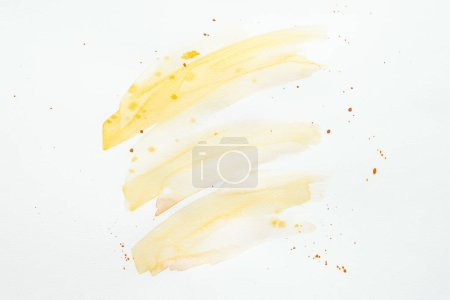 abstract orange watercolor strokes and blots on white paper background