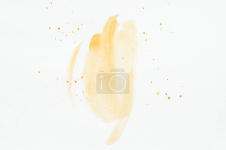 Photo for Orange watercolor strokes with splatters on white paper - Royalty Free Image