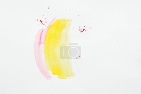 abstract painting with yellow and pink watercolor strokes with red splatters