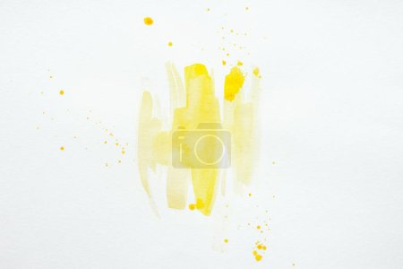 Photo for Abstract yellow watercolor splatters on white paper background - Royalty Free Image