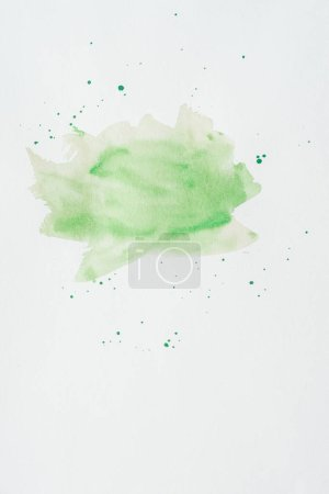 abstract green watercolor stroke on white paper