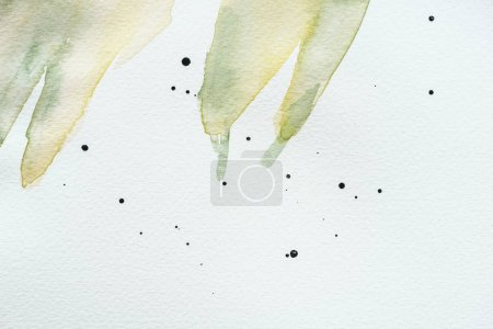 abstract green watercolor painting with splatters on white paper