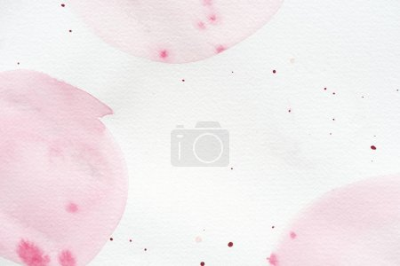 abstract background with light pink watercolor painting and splatters