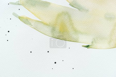 abstract green and yellow watercolor painting on white paper