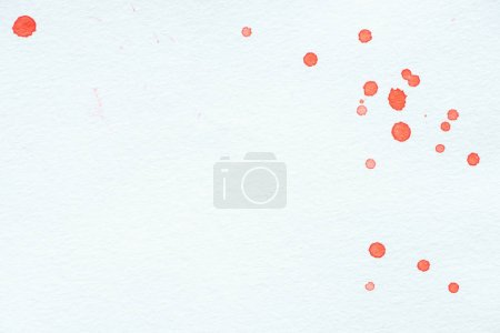 abstract red watercolor drops on white paper background with copy space