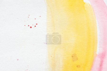 pink and yellow paint strokes with red splatters on white paper background