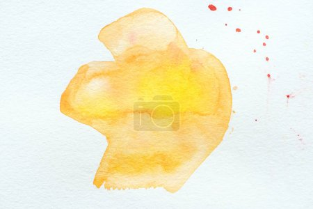 abstract orange and yellow watercolor painting on white paper