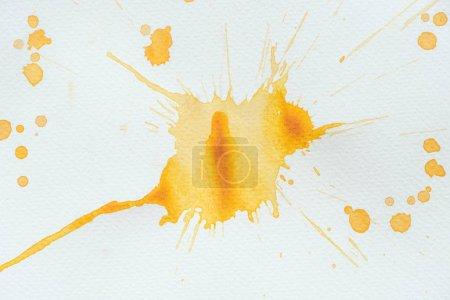 Photo pour Aquarelle orange abstraite éclaboussure sur papier blanc - image libre de droit