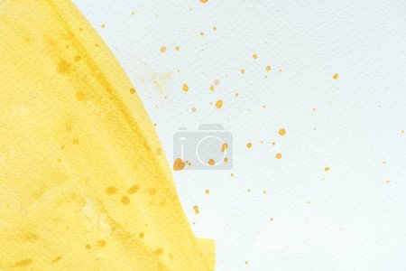 abstract close up background with yellow watercolor stroke with splatters