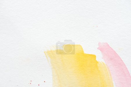 abstract background with yellow and pink watercolor strokes