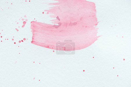 abstract background with light pink watercolor strokes and splatters