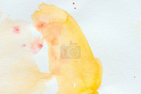 abstract yellow watercolor stroke on white paper