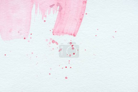abstract background with pink watercolor strokes and splatters