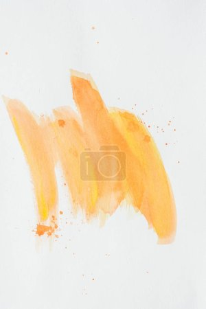 Photo pour Orange strokes aquarelles sur papier blanc - image libre de droit
