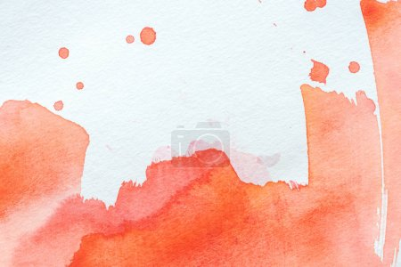creative background with red watercolor strokes on white paper