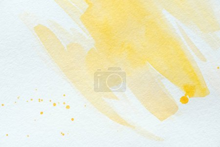 Photo for Artistic yellow watercolor strokes on white paper - Royalty Free Image