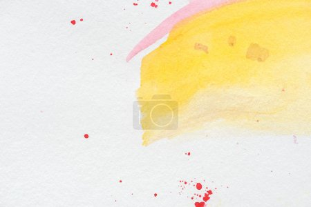 abstract background with yellow and pink watercolor strokes with red splatters