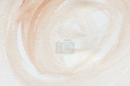 close up of abstract brown watercolor painting on white paper