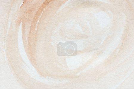 gros plan d'abstrait aquarelle brune sur papier blanc