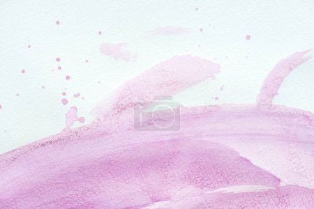 abstract violet watercolor painting with splatters on white paper