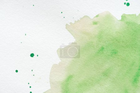 abstract green watercolor background with splatters