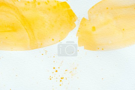 Photo for Abstract yellow watercolor strokes on white paper - Royalty Free Image