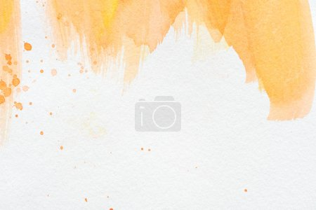 abstract orange watercolor painting on white paper