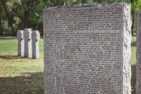 close up view of memorial tombstone with lettering at graveyard