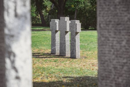 selective focus of identical gravestones placed in row at graveyard