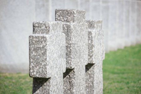 close up view of old memorial headstones placed in row at cemetery