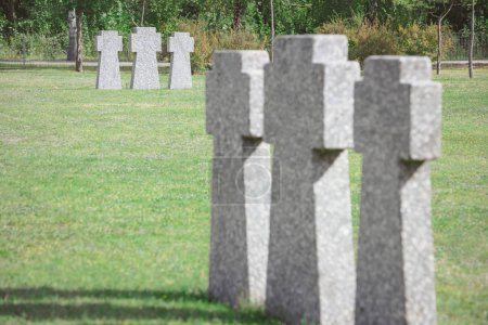 selective focus of cemetery with old memorial headstones placed in rows