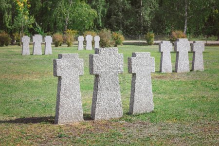 graveyard with identical old memorial headstones placed in rows