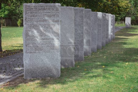 old memorial gravestones with lettering at cemetery